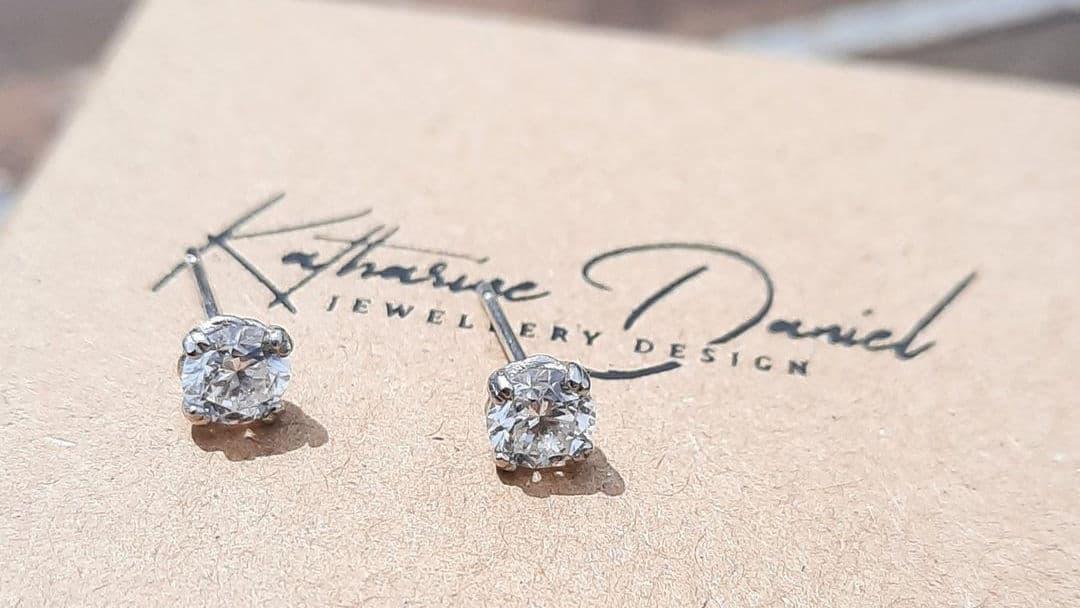 Diamond stud earrings set in platinum bespoke settings